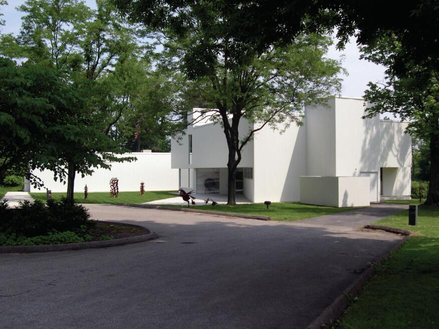 The Mansfield Art Center is set within a grove of trees.