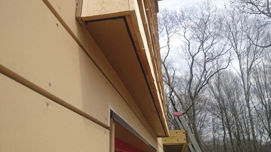 The mesh extends to the bottom of the rainscreen to provide a measure of ventilation for the siding, as well.