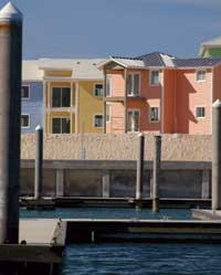 DREAM IN COLOR: These condos at Bimini Bay Resort and Casino feature siding from Alcoa's DreamColor line, a new set of exterior products available in a baseline palette of 700 colors. The island hues were custom created to match local flowers. The DreamColor line includes siding, soffit, fascia, and accents to shutters and window treatments.