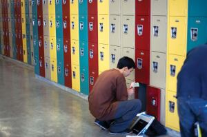 "A student stops by his locker at the Miguel Contreras Learning Complex, a high school in west central Los Angeles that opened its doors in September 2006. Designed by Johnson Fain as an ""urban village"" surrounding a central courtyard, the school has 2,500 students, many of whom had previously been bused to schools outside their neighborhoods because of systemwide overcrowding."