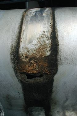 Chemicals that dissolve snow and ice also attack trucks. Salt spray corroded this aluminum fuel tank.