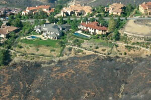 """The Bridges, a Lennar Homes luxury development in Rancho Santa Fe, Calif., withstood wildfires that torched hundreds of other buildings in the area by applying """"Firewise"""" landscaping techniques and building details. (Photo by Rancho Santa Fe Fire Protection District)"""