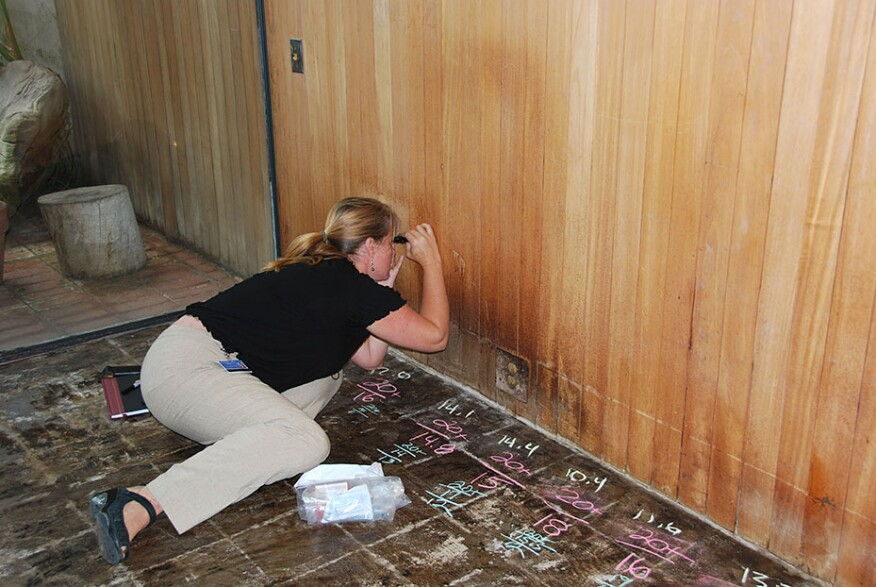GCI assistant scientist Joy Mazurek conducts a wood panel investigation at the Eames House, one of the model field study projects