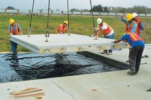 Repairing roads with precast concrete