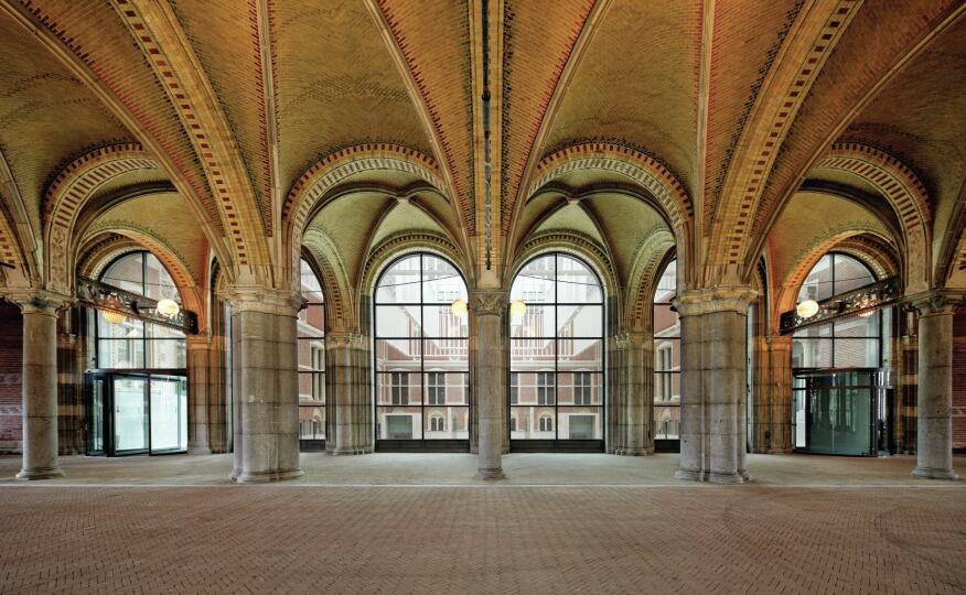 The ribbed, tiled vaults of the Museum Passageway beneath the Gallery of Honor were restored; arched windows overlook the renovated courtyards on either side.