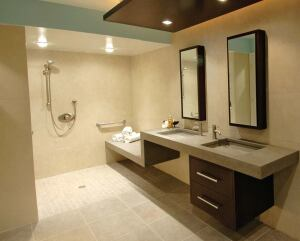 "The shower's parallel ""wet"" and ""dry"" benches allow a caretaker to stay dry while helping the client's son bathe."