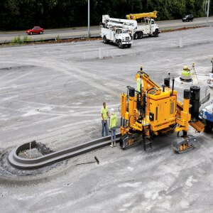 The GOMACO GT-3600 with Topcon mmGPS 3D machine guidance slipforms tight radii curb and gutter on a parking lot project.