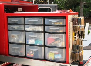 The storage unit contains a series of ready-made plastic drawer units from an office supply store. The drawer fronts are clear so it's easy to see what's inside.
