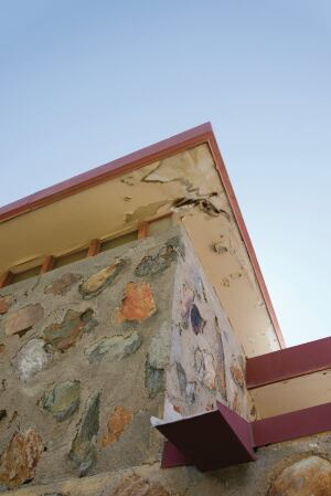 Subject to the extreme weather of the Arizona desert, water-damaged soffits under the roof eaves reveal the aging of Taliesin West.