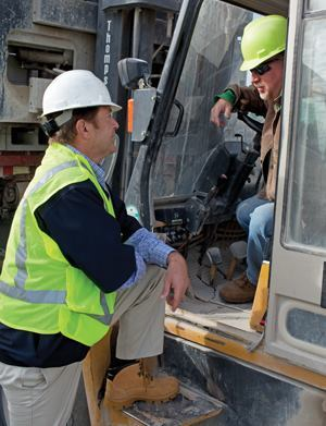 Major Ogilvie talks with yardman Jeff Hill at Block USA's plant in Birmingham, Ala.