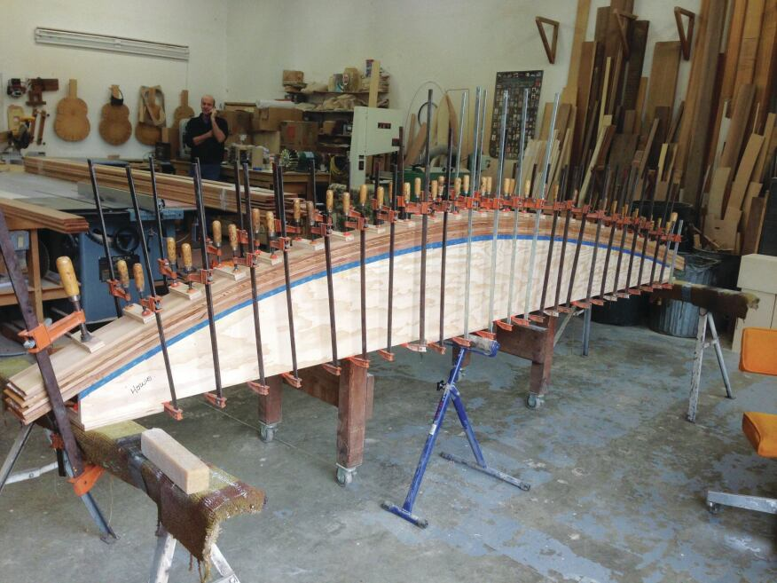The curved cedar trusses were laminated in the shop.