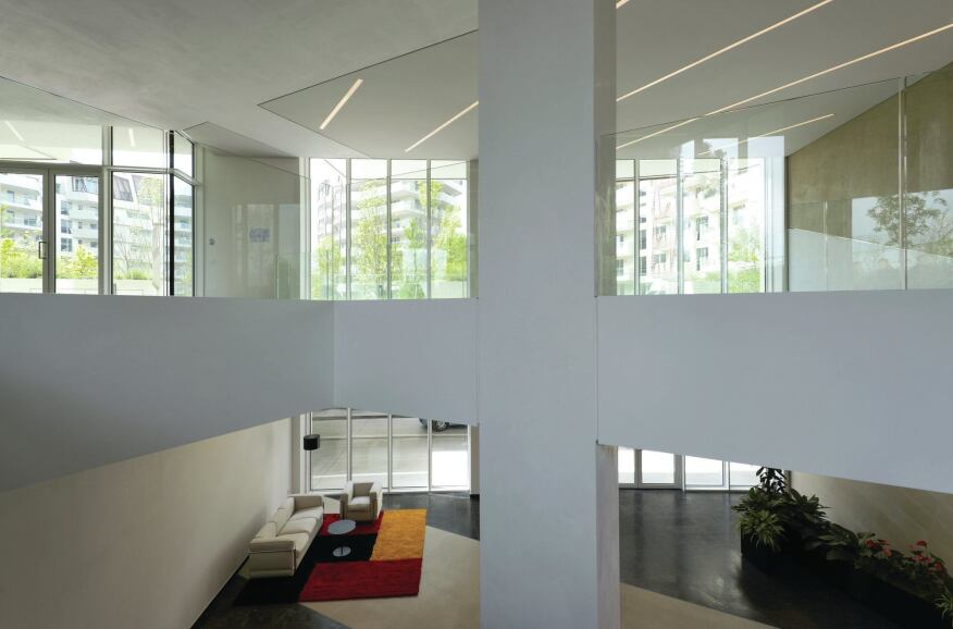 A double-height lobby in the Libeskind residences allows for access from both the lower roadway—sunken to avoid cluttering the site with vehicular traffic—and the landscaped courtyard above.