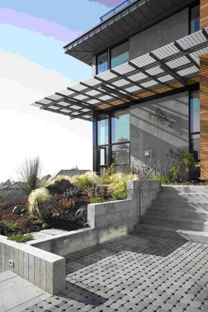 Permeable pavers manage water runoff, control pollutants, and prevent erosion around this LEED-certified home by McDonald Construction & Development in Oakland, Calif.  www.margaridohouse.com