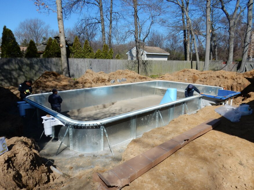 The cause for rejoicing is this 16-by-32-foot, vinyl-liner pool with steel panels and a hard bottom, shown under construction by LIPSA members. Once the backyard transformation is complete and warm weather arrives, it won't be hard to guess where Tyler and his brother, Nicholas, will be.