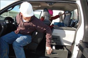 The Ultimate Field Office converts the space behind the front seats of extended pickup trucks into a functional mobile office.