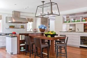 """The main kitchen strikes a comfortable balance between refinement and utility. Stainless steel """"boots"""" protect the kickspace's outside corners."""