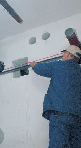 Plumbers don't want certain things level. To be sure it's running downhill, set up a quick reference line using a laser.