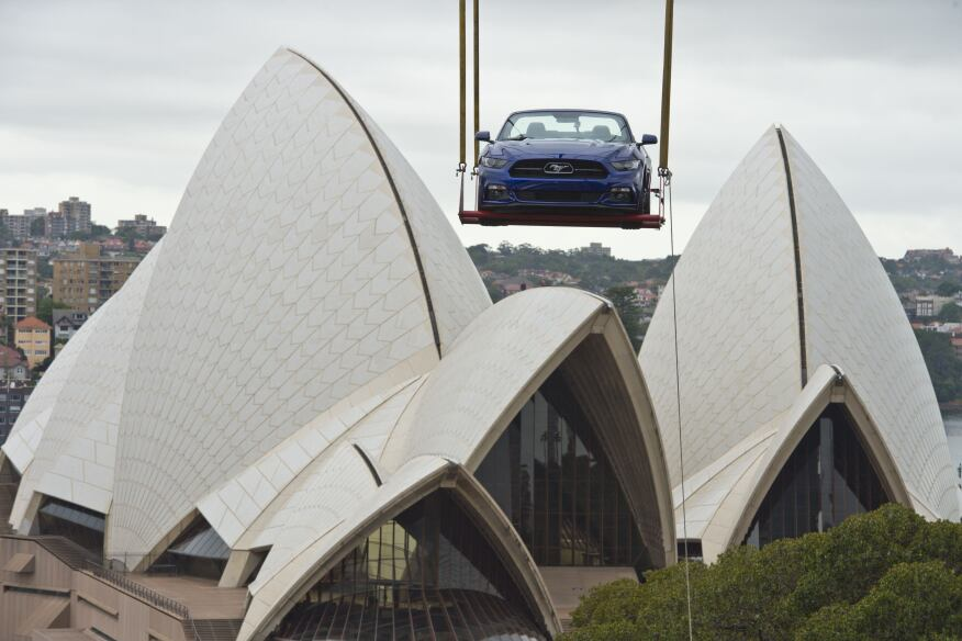 Launched skyward in the early hours of the morning by crane, this GT convertible Mustang ascended a Sydney high-rise building next to the Opera House and Sydney Harbour Bridge to prepare for a breathtaking view of one of the world's most iconic New Year's Eve events. This caps a history-making year in which the Mustang also scaled the Empire State Building and Burj Khalifa, the world's tallest skyscraper in Dubai, to celebrate the iconic pony car's 50th Anniversary.