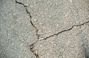 Old asphalt pavement with cracks after frost damage
