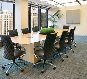 Like the CEO's office, the large conference room receives a steady stream of afternoon light from the floor-to-ceiling windows.