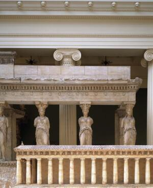 Receding façades: In the Carnegie's Hall of Architecture, a model of the Parthenon sits in front of a plaster cast of the Porch of the Caryatids from the Erechtheum, a temple on the Acropolis in Athens, Greece.