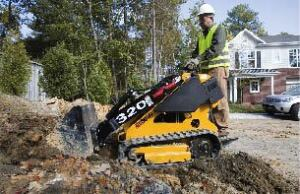 Figure 8. While you wouldn't want to dig a house foundation with one, subcompact loaders handle the equivalent of eight to 10 joint-compound buckets of dirt at a scoop and make quick work of the light excavation common to deck building.