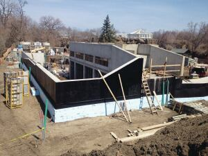Elliot Construction moved upward from building residential basements.