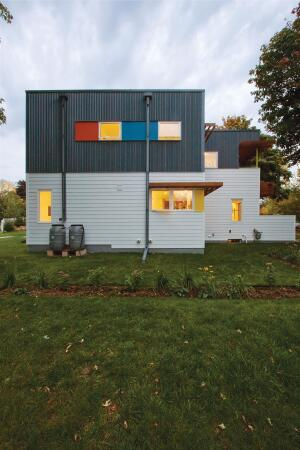 Angular lines and a box structure transformed the former Cape Cod-style house into a contemporary showpiece.