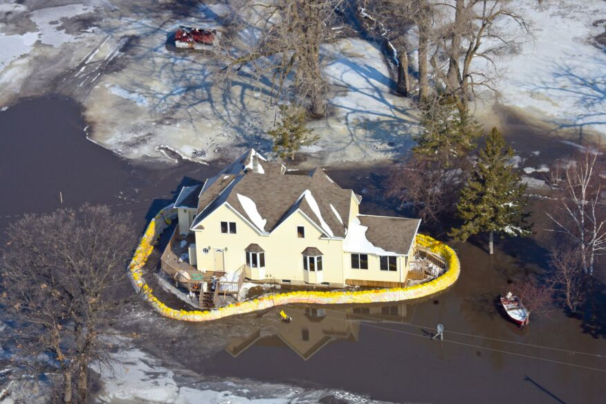 Sandbags supply emergency protection or a house in flooded farmland near the Red River in Hendrum, Minnesota in March, 2009.