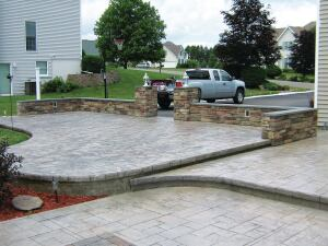 This ashlar slate pattern had to match decorative work Bolster had done for the homeowner two years earlier. He created a cut stone effect using homemade custom form liners on the sides of the slabs. From excavation to capstones, Bolster had 2-1/2 weeks to complete the work in time for an outdoor party.