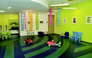 PARTY TIME: Kids keep busy in the playroom at Cielo, a New York City condo community developed by J.D. Carlisle Development Corp.