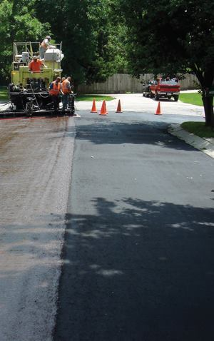 By using pavement preservation treatments such as micro surfacing (shown here), in conjunction with mill-and-fill cycles, agencies can save up to $500,000 per two-lane mile over a 50-year period when compared to mill-and-fill-only programs. To most effectively stretch the budget, target up to 40% of paving dollars to preservation. Photo: ISSA
