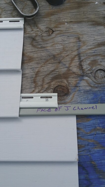 The second method is cutting the face off J-channel and inserting it into the locking strip of the lower panel.