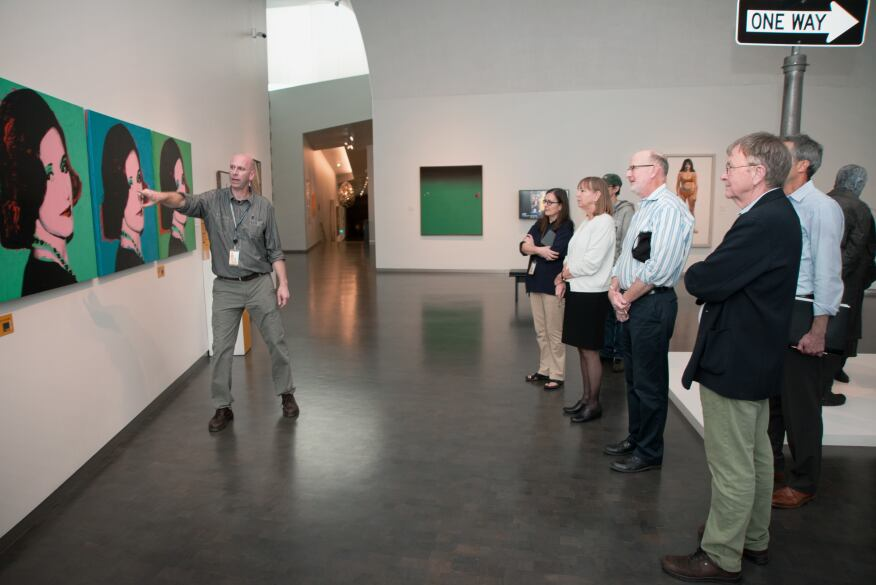 Lighting designer Clint Paugh shows museum staff how the museum's different artworks look under LED lighting.