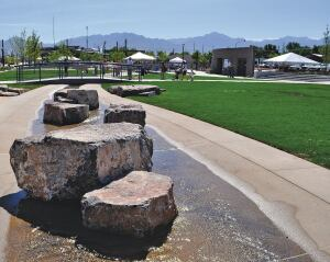 Three bridges cross a manmade stream that wanders through downtown West Valley City, Utah. They're made of Bomanite imprinted with a 6-in. boardwalk plank design to simulate concrete's pattern and texture.