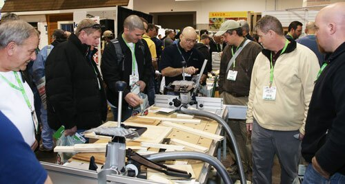 A group of JLC Live attendees check out new products on the tradeshow floor.