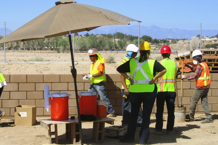 In hot weather, it's the employer's duty to provide workers with a shady place for rest breaks, and with ready access to clean, cool drinking water. There has to be enough water for every worker to consume a quart of water an hour throughout the working shift. In the example above, the employer has set up an insulated water jug with a paper-cup dispenser. On inspection visits, Cal/OSHA will check to see if the jugs are kept filled, so the author recommends designating someone to replenish the supply.