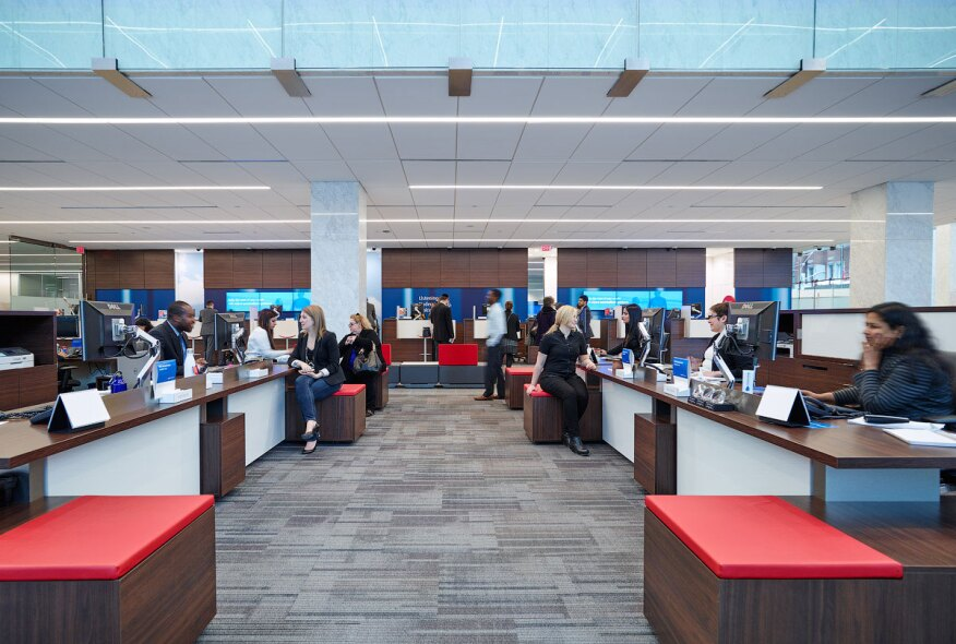 The new lighting strategy provides uniform illumination at the customer service desks, which are located under the mezzanine and extend into the double-height banking hall.