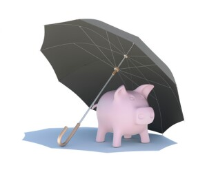 Umbrella covering the pink piggy bank. Isolated on white background