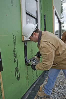 Huber Engineered Woods Zip System Tape Gun Remodeling