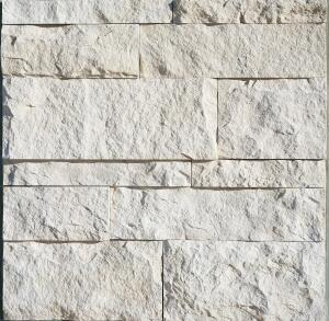 "Eldorado Stone's latest stone veneer profile is the Cut Coarse Stone, which is fabricated to resemble saw-cut Turkish limestone. The profile is textured but linear for a more modern line, and manufactured at a scale the company believes increases installation efficiency. Available in 9"", 6"", and 3"" heights, with lengths between 12"" and 24"", the profiles install with a dry-stack application. Cut Coarse Stone is available as a Western Region profile and comes in an off-white Oyster hue.  eldoradostone.com"