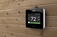 Schneider Electric's New Thermostat Goes Head to Head with Nest