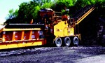 Recyclers charge lower tipping fees and grind up asphalt shingles for reuse in hot-mix pavement.