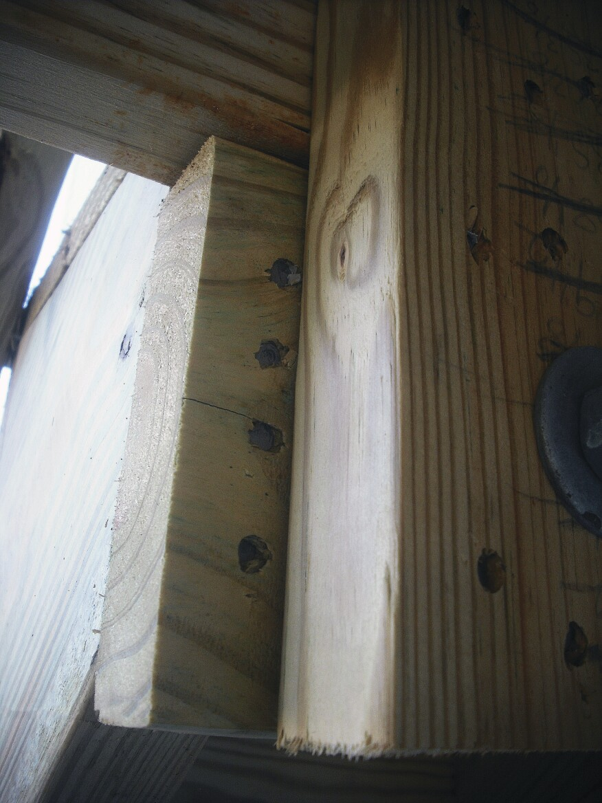 Attaching stringers to a dropped header with nails as shown here is a risky fastening method because nails driven into lumber end grain have minimal resistance to withdrawal.