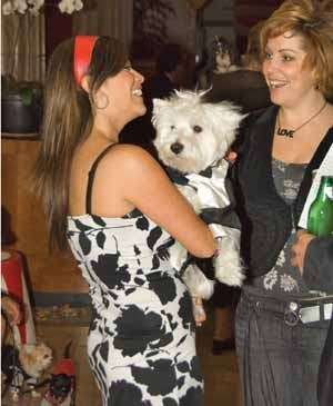PARTY ANIMALS: Metro, a property pet mascot, greets and entertains prospective tenants, signaling that pets are welcome.