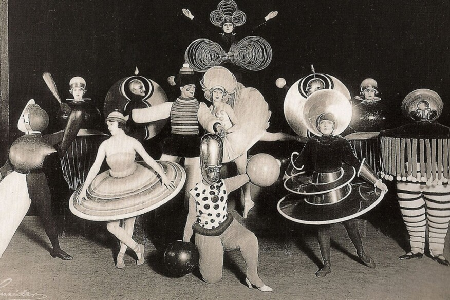 A group of performers from a Triadisches ballet by Oskar Schlemmer, produced during his time with the Bauhaus (1927)