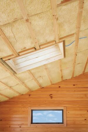 Fibreglass insulation installed in the sloping ceiling of a timber house. More building a home:- [url=http://www.istockphoto.com/file_search.php?action=fileandlightbo