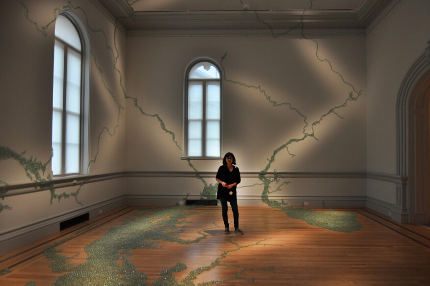 Maya Lin stands within her piece, Folding the Chesapeake, 2015