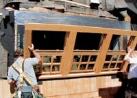 Chuck Bergerson, of Bergerson Cedar Windows, installs one of the traditional cedar double-hungs his company produces.