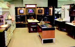 Norsk Remodeling's exhibit space features two kitchens ó one modern, one  traditional ó that showcase brand-new products loaned by its suppliers.